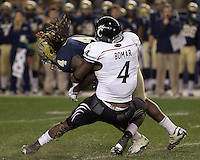 Cincinnati linebacker Maalik Bomar (4) tackles Pitt running back Zach Brown. Cincinnati Bearcats defeated the Pitt Panthers 26-23 at Heinz Field in Pittsburgh, Pennsylvania on November 5, 2011.