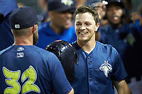 Brian Sharp (7) of the Columbia Fireflies is greeted by pitching coach Royce Ring (32) after hitting a 3-run home run against the Rome Braves at Segra Park on May 13, 2019 in Columbia, South Carolina. The Fireflies defeated the Braves 6-1 in game two of a doubleheader. (Brian Westerholt/Four Seam Images)