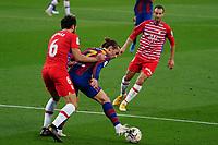 29th April 2021; Camp Nou, Barcelona, Catalonia, Spain; La Liga Football, Barcelona versus Granada; Antoine Griezmann FC Barcelona holds off the challenge from Germán Sánchez Barahona of Granada CF
