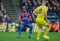 Wilfried Zaha of Crystal Palace during the Premier League match between Crystal Palace and Chelsea at Selhurst Park, London, England on 30 December 2018. Photo by Andrew Aleks.<br /> .<br /> (Photograph May Only Be Used For Newspaper And/Or Magazine Editorial Purposes. www.football-dataco.com)
