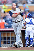 Toledo Mud Hens third baseman Mike Hessman #27 reacts to striking out during a game against the Durham Bulls at Durham Bulls Athletic Park on July 25, 2014 in Durham, North Carolina. The Mud Hens defeated the Bulls 5-3. (Tony Farlow/Four Seam Images)