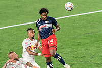 FOXBOROUGH, MA - MAY 22: Jon Bell #23 of New England Revolution heads the corner kick wide during a game between New York Red Bulls and New England Revolution at Gillette Stadium on May 22, 2021 in Foxborough, Massachusetts.