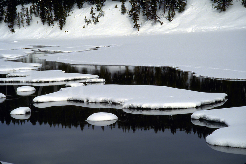 Snow patterns on the river, Yellowstone National Park, winter. Wyoming, Yellowstone National Park.
