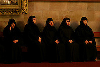 Greek Orthodox Nuns are seen during a mass in the Holy Sepulcher, in the Old City of Jerusalem, March 19, 2006