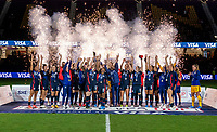 ORLANDO, FL - FEBRUARY 24: Becky Sauerbrunn #4 and Crystal Dunn #19 of the USWNT raise the SheBelieves Cup trophy during a game between Argentina and USWNT at Exploria Stadium on February 24, 2021 in Orlando, Florida.