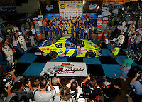 Nov 13, 2005; Phoenix, Ariz, USA;  Nascar Nextel Cup driver Kyle Busch driver of the #5 Kellogs Chevy celebrates his victory in the Checker Auto Parts 500 at Phoenix International Raceway. Earlier in the day his brother 2004 Nextel Cup Champion Kurt Busch was pulled from the car for the rest of the season after being arrested for wreckless driving Friday night in nearby Avondale, Ariz. Mandatory Credit: Photo By Mark J. Rebilas