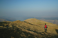 A walker descending from the summit of Binnein an Fhidhlier, the Arrochar Alps, looking towards Loch Fyne, Argyll & Bute<br /> <br /> Copyright www.scottishhorizons.co.uk/Keith Fergus 2011 All Rights Reserved