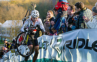 29 NOV 2014 - MILTON KEYNES, GBR - Jack Ravenscroft (GBR) from Great Britain is cheered on by spectators as he runs up a climb during the men's 2014-2015 UCI Cyclo-Cross World Cup round in Campbell Park in Milton Keynes, Great Britain (PHOTO COPYRIGHT © 2014 NIGEL FARROW, ALL RIGHTS RESERVED)