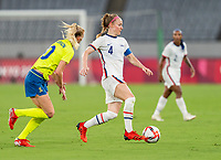 TOKYO, JAPAN - JULY 21: Becky Sauerbrunn #4 of the USWNT dribbles during a game between Sweden and USWNT at Tokyo Stadium on July 21, 2021 in Tokyo, Japan.