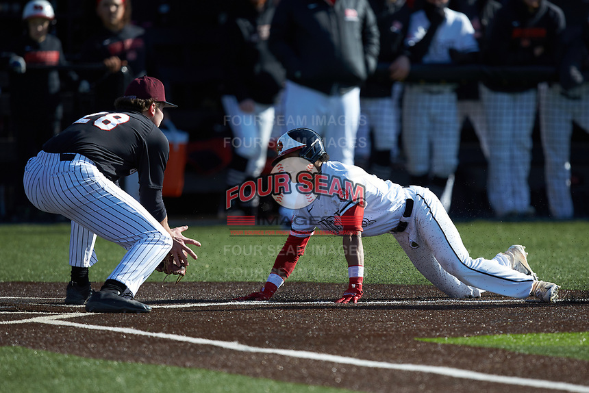 Jeremy Whitehead (8) of the North Greenville Crusaders is caught in a run down and tagged out by Bellarmine Knights starting pitcher Brandon Pfaadt (28) at Ashmore Park on February 7, 2020 in Tigerville, South Carolina. The Crusaders defeated the Knights 10-2. (Brian Westerholt/Four Seam Images)