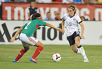 Heather O'Reily (9) of the USWNT goews against Kenti Robles (2) of Mexico.  The USWNT defeated Mexico 7-0 during an international friendly, at RFK Stadium, Tuesday September 3 , 2013.
