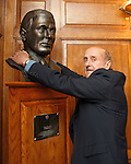 Johnny Hubbard pauses on the marble staircase and gives a hug to the statue of Bill Struth his manager at Rangers