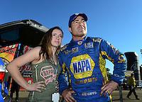 Nov. 11, 2012; Pomona, CA, USA: NHRA funny car driver Ron Capps (right) with his daughter Taylor Capps during the Auto Club Finals at at Auto Club Raceway at Pomona. Mandatory Credit: Mark J. Rebilas-