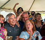 "June 20, 2020: Principal owners of Sackatoga Stables, Jack Knowlton and Ed Mitzen celebrate with other partners and friends  as Tiz the Law won the 152nd Belmont Stakes.  ""Tiz"" is the first New York bred since 1882 to win the event.  The ""watch party was at Pennell's fine eatery in Saratoga Springs, New York.  Heary/Eclipse Sportswire/CSM"