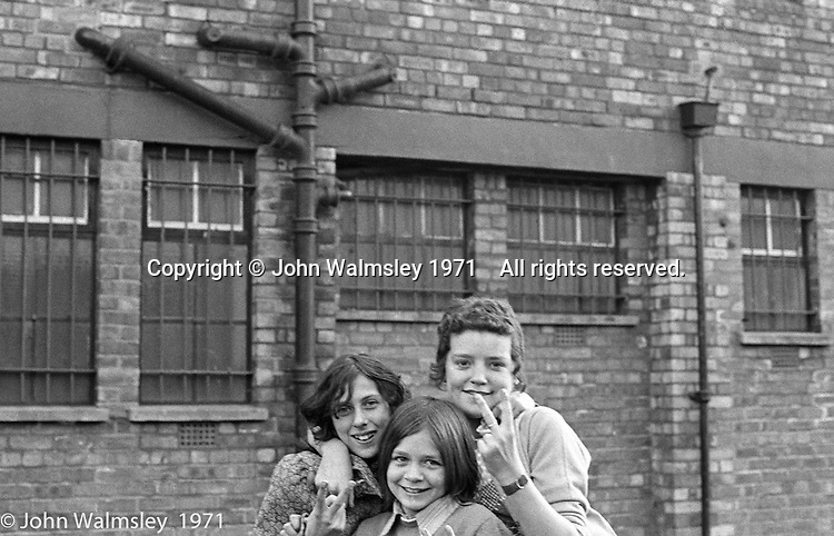 Having fun outside the building, Scotland Road Free School, Liverpool  1971.  Also known as the Scotland Road or Scottie Road Free School it was founded and run by two teachers, John Ord and Bill Murphy (if I've got these names wrong, please tell me!) who worked with truanting kids and provided somewhere to go and things to do.  They begged and borrowed an old building, desks, books and an old ambulance for trips.
