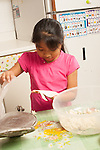 7 year old girl taking flattened tortilla press
