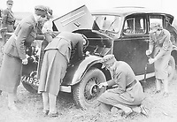 BNPS.co.uk (01202 558833)<br /> Pic: Pen&Sword/BNPS<br /> <br /> PICTURED: The 1937 F.A.N.Y. camp: vehicle maintenance, a skill still practised by the Corps.<br /> <br /> These inspiring photos of nurses on the front line feature in a new book which charts a century's heroic wartime service.<br /> <br /> The First Aid Nursing Yeomanry (FANY) was founded in 1907 by Captain Edward Baker with the early recruits trained in cavalry, signalling and camping.<br /> <br /> They were despatched to France at the outset for World War One to tend to injured troops on the battlefield, setting up hospitals for the many casualties. Other heroines dragged wounded personnel from exploding ammunition dumps.<br /> <br /> The brave nurses were again in the centre of the action in World War Two, performing sterling work in the harshest of conditions.<br /> <br /> Their stories feature in The First Aid Nursing Yeomanry in War and Peace, by Hugh Popham.
