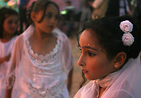 "Young brides in the celebration organized by the Hamas movement, a collective marriage 110 bridegroom and the bride in the town of Beit Lahia in the northern Gaza Strip, August 2, 2007 .""photo by Fady Adwan"""