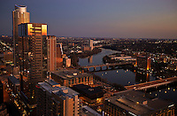 The W Hotel, Austonian, and 100 Congress building Austin skyline skyscrapers neon lights reflect a beautiful afternoon sunset over looking lady bird lake