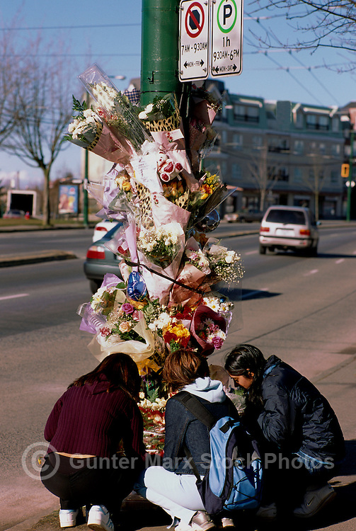 Teenage Girls mourning at Roadside Memorial Shrine of Flowers for Victims killed in Fatal Car Accident, Vancouver, BC, British Columbia, Canada - Speeding kills Teenagers