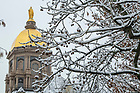 January 4, 2020; The Statue of Mary atop the Golden Dome during a snowfall.  (Photo by Barbara Johnston/University of Note Dame)