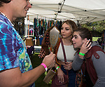 Hailey and Mekayla are helped by Michael Anderson during the inaugural Bud and Brew Music Festival in Wingfield Park in downtown Reno on Saturday, Sept. 23, 2017.