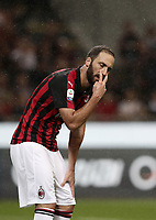 Calcio, Serie A: AC Milan - AS Roma, Milano stadio Giuseppe Meazza (San Siro) 31 agosto 2018. <br /> AC Milan's Gonzalo Higuain reacts during the Italian Serie A football match between Milan and Roma at Giuseppe Meazza stadium, August 31, 2018. <br /> UPDATE IMAGES PRESS/Isabella Bonotto