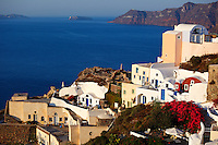 Houses with traditional architectural style in Oia of Santorini, Greece