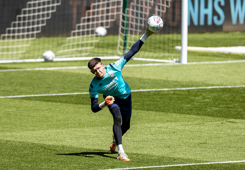 Leeds United's Illan Meslier warming up before the match  <br /> <br /> Photographer Andrew Kearns/CameraSport<br /> <br /> The EFL Sky Bet Championship - Swansea City v Leeds United - Sunday 12th July 2020 - Liberty Stadium - Swansea<br /> <br /> World Copyright © 2020 CameraSport. All rights reserved. 43 Linden Ave. Countesthorpe. Leicester. England. LE8 5PG - Tel: +44 (0) 116 277 4147 - admin@camerasport.com - www.camerasport.com