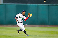 Cedar Rapids Kernels outfielder J.D. Williams #2 catches a fly ball during a game against the Kane County Cougars at Veterans Memorial Stadium on June 8, 2013 in Cedar Rapids, Iowa. (Brace Hemmelgarn/Four Seam Images)