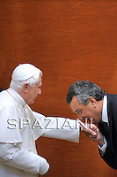 Pope Benedict XVI from Paolo Barelli (R), president of the Italian Swimming Federation during the audience of the Rome world swimming championships outside of his summer residence in Castelgandolfo, south of Rome on August 1, 2009