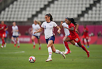 KASHIMA, JAPAN - AUGUST 2: Alex Morgan #13 of the United States with the ball during a game between Canada and USWNT at Kashima Soccer Stadium on August 2, 2021 in Kashima, Japan.