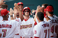 Memphis Redbirds second baseman Bruce Caldwell high fives with his teammates in the dugout during a game against the Iowa Cubs on May 29, 2017 at AutoZone Park in Memphis, Tennessee.  Memphis defeated Iowa 6-5.  (Mike Janes/Four Seam Images)