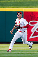 Thomas Pham (4) of the Springfield Cardinals attempts to make a play on a fly ball to center field during a game against the Tulsa Drillers on April 29, 2011 at Hammons Field in Springfield, Missouri.  Photo By David Welker/Four Seam Images.