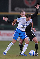 Kansas City Wizards midfielder Davy Arnaud (22) fights to keep possession of the ball while defended by DC United defender Bryan Namoff (26). The Kansas City Wizards defeated DC United 4-2, in the home opener for DC United at RFK Stadium, April 14, 2007.