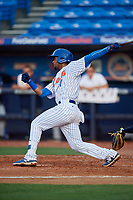St. Lucie Mets second baseman Luis Carpio (11) follows through on a swing during the first game of a doubleheader against the Charlotte Stone Crabs on April 24, 2018 at First Data Field in Port St. Lucie, Florida.  St. Lucie defeated Charlotte 5-3.  (Mike Janes/Four Seam Images)