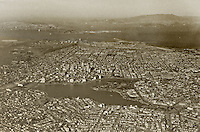 historical aerial photograph of Lake Merritt and downtown Oakland, California, with San Francisco and the Golden Gate bridge in the background, 1938