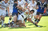 Sam Tuitupou of Sale Sharks is tackled just short of the tryline by (L-R) Stephen Donald and Olly Barkley of Bath Rugby during the Aviva Premiership match between Bath Rugby and Sale Sharks at the Recreation Ground on Saturday 29th September 2012 (Photo by Rob Munro)