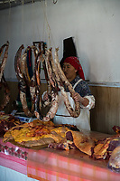 Mongolia, Bayan-Ulgii, Ulgii, Altai Mountains. Meat for sale in local market.