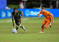 LAKE BUENA VISTA, FL - JULY 18: Yimmi Chará #23 of the Portland Timbers dribbles away from Adam Lundkvist #3 of the Houston Dynamo during a game between Houston Dynamo and Portland Timbers at ESPN Wide World of Sports on July 18, 2020 in Lake Buena Vista, Florida.
