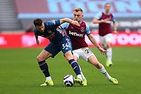 21st March 2021; London Stadium, London, England; English Premier League Football, West Ham United versus Arsenal; Granit Xhaka of Arsenal under pressure from Jarrod Bowen of West Ham United