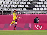 KASHIMA, JAPAN - AUGUST 5: Sam Kerr #2 of Australia takes a header over Becky Sauerbrunn #4 of the USWNT during a game between Australia and USWNT at Kashima Soccer Stadium on August 5, 2021 in Kashima, Japan.