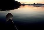 Alaska, Prince William Sound, sea kayaking, paddler's eye view of Knight Island, Knight Island Passage, Chugach Range at sunset..