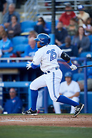 Dunedin Blue Jays designated hitter Juan Kelly (25) follows through on a swing during a game against the Clearwater Threshers on April 8, 2017 at Florida Auto Exchange Stadium in Dunedin, Florida.  Dunedin defeated Clearwater 12-6.  (Mike Janes/Four Seam Images)