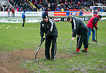 Brechin v St Johnstone....12.03.11  Scottish Cup Quarter Final.Jim Weir and the Brechin ground staff work on the pitch before kick off to make sure the game went ahead after the snow and rain waterlogged the pitch.Picture by Graeme Hart..Copyright Perthshire Picture Agency.Tel: 01738 623350  Mobile: 07990 594431