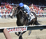 Upstart (no. 2), ridden by Jose Ortiz and trained by Richard Violette Jr., wins the 1st running of the Funny Cide Stakes for two year olds on August 24, 2014 at Saratoga Race Course in Saratoga Springs, New York.  (Bob Mayberger/Eclipse Sportswire)