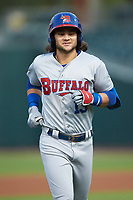 Buffalo Bisons shortstop Bo Bichette (13) jogs off the field after making an out against the Caballeros de Charlotte at BB&T BallPark on July 23, 2019 in Charlotte, North Carolina. The Bisons defeated the Caballeros 8-1. (Brian Westerholt/Four Seam Images)