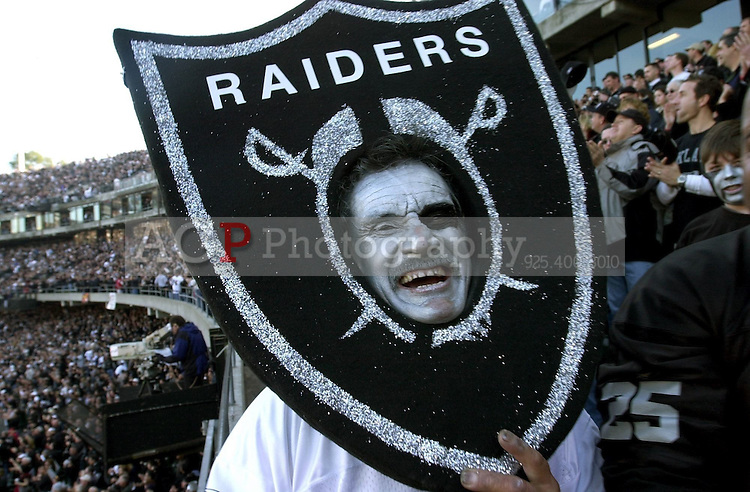 Jan 19, 2003 - OAKLAND, California, USA - Oakland Raiders Fan RALPH MARTINEZ of Santa Maria, Calif., is all smiles at the AFC Championship game between the Oakland Raiders and the Tennessee Titans at Network Associates Coliseum in Oakland, Calif., Sunday January 19 2003. .(Credit Image: © Alan Greth)