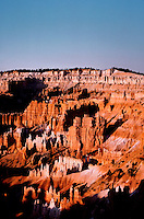 Western landscape of sunrise over the Queens Garden rock formations in Bryce Canyon National Park. Utah.