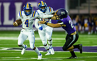 Malachi Gober (4) of North Little Rock with the quarterback keeper runs away from Cross Garner (24) of Fayetteville against Fayetteville at Harmon Field , AR, on Friday,September 10, 2021 / Special to NWADG David Beach